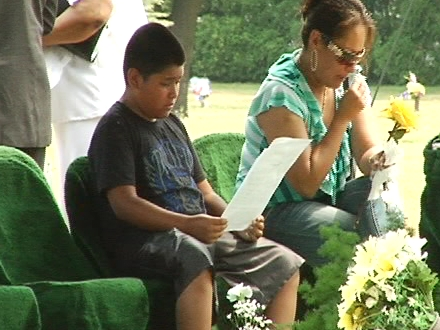 Community members gathered to mourn the infant's death at Ottawa Hills Park.