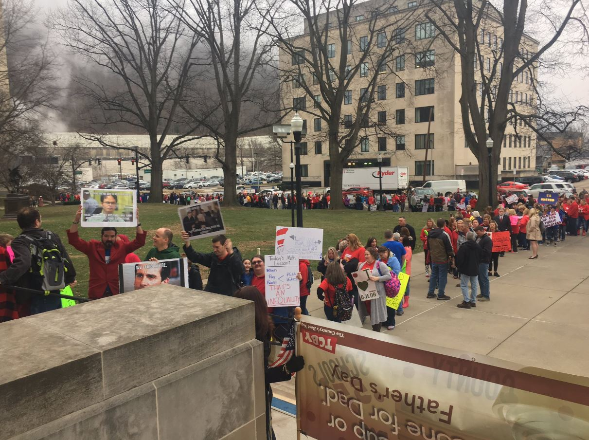 A line of teachers and supporters line the sidewalks around the Capitol. (WCHS/WVAH)<p></p>