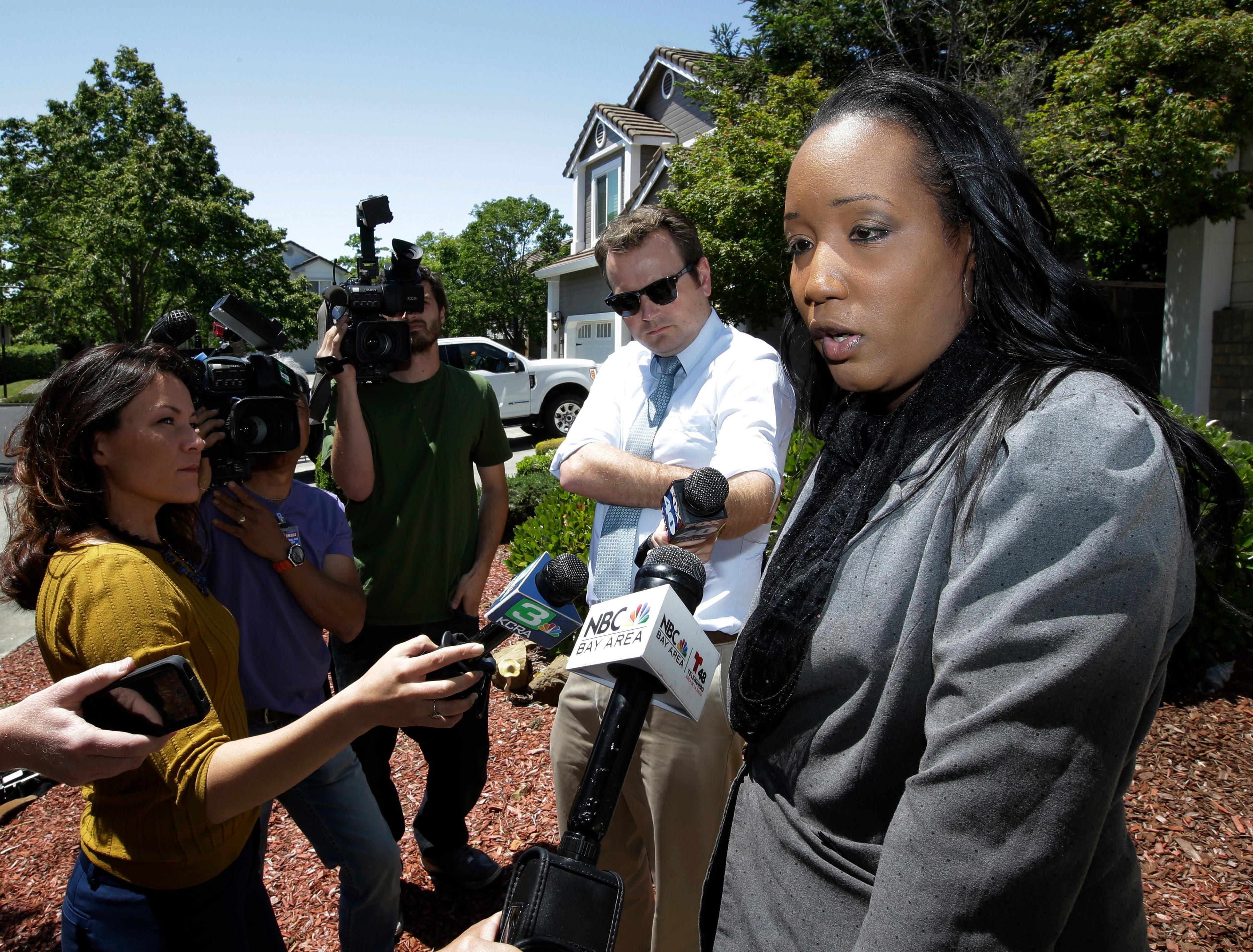 Ina Rogers talks with reporters about the seizure of her 10 children by law enforcement Monday, May 14, 2018, in Fairfield, Calif. Authorities removed the children living at their home on March 31, and placed them in protective custody after one of them ran away. Rogers faces charges of child neglect and her husband Jonathan Allen has been charged with torture and child abuse. Rogers denied the children were mistreatment. (AP Photo/Rich Pedroncelli)