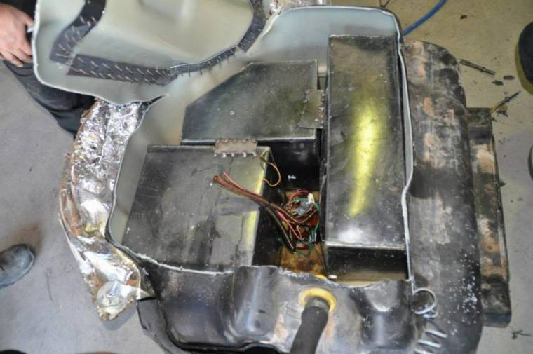 The department says the marijuana was hidden inside a compartment inside the SUV's fuel tank.