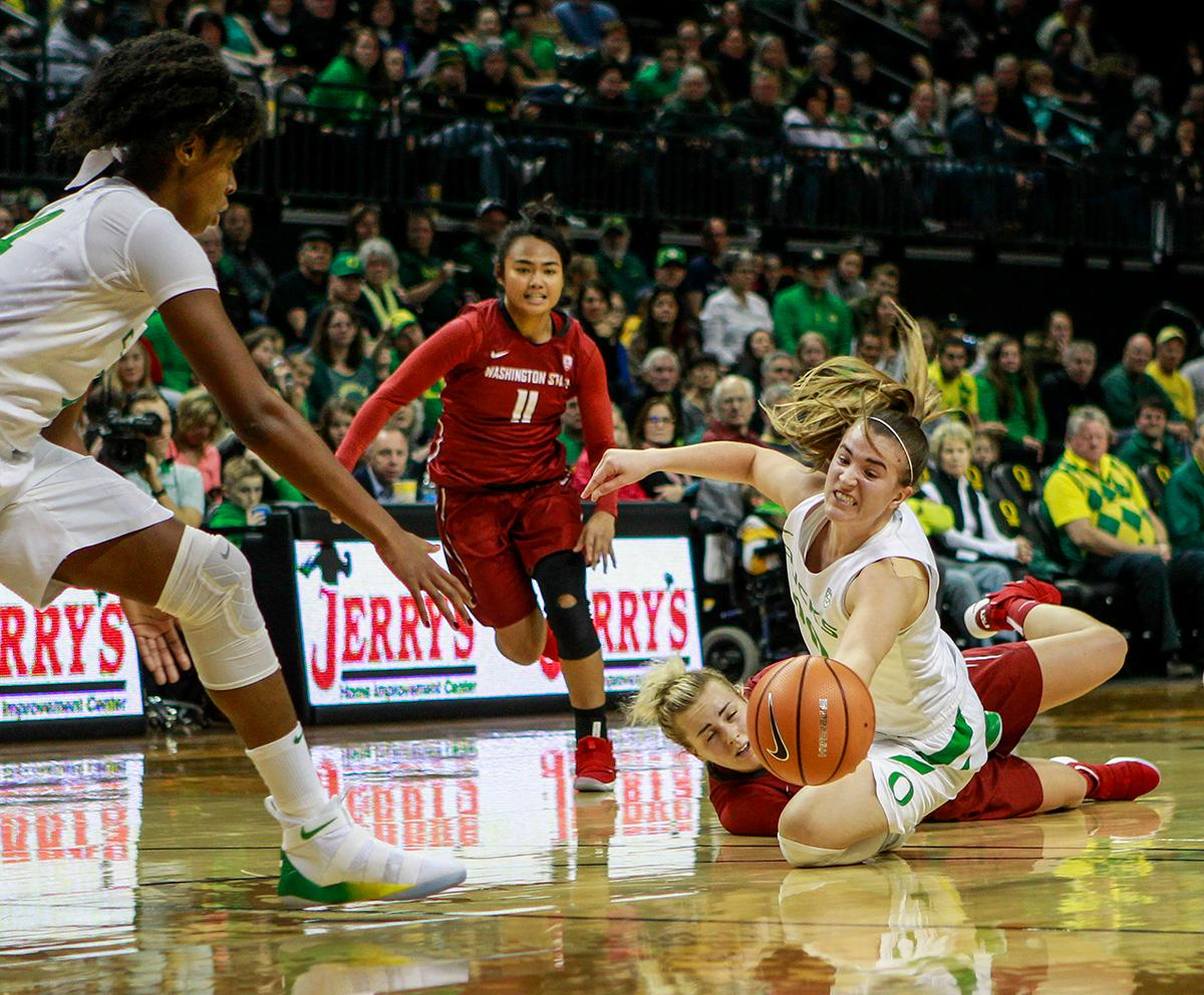 Oregon Ducks Sabrina Ionescu (#20) fights for control of a lose ball. In their first conference basketball game of the season, the Oregon Women Ducks defeated the Washington State Cougars 89-56 in Matt Knight Arena Saturday afternoon. Oregon's Ruthy Hebard ran up 25 points with 10 rebounds. Sabrina Ionescu shot 25 points with five three-pointers and three rebounds. Lexi Bando added 18 points, with four three-pointers and pulled down three rebounds. Satou Sabally ended the game with 14 points with one three-pointer and two rebounds. The Ducks are now 12-2 overall with 1-0 in conference and the Cougars stand at 7-6 overall and 0-1 in conference play. The Oregon Women Ducks next play the University of Washington Huskies at 1:00 pm on Sunday. Photo by Rhianna Gelhart, Oregon News Lab