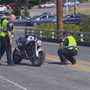 Motorcyclist crashes off edge of Ballard Bridge, falls 20 feet below