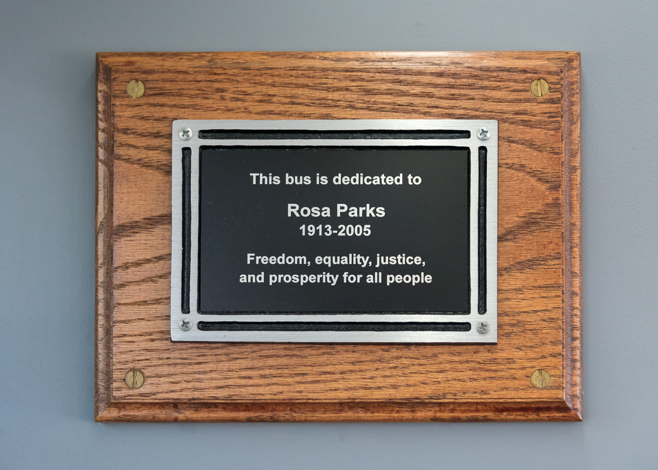 A plaque inside one of the new Metro busses bears the name of Rosa Parks. / Image: Phil Armstrong, Cincinnati Refined // Published: 1.22.19