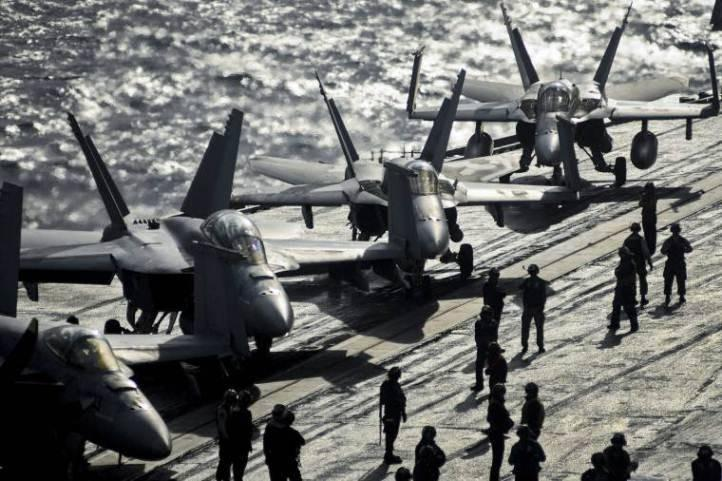 U.S. Navy sailors prepare aircraft to launch from the aircraft carrier USS Nimitz in the Mediterranean Sea. The Nimitz is deployed to support maritime security operations and theater security cooperation efforts in U.S. 6th Fleet area of responsibility.