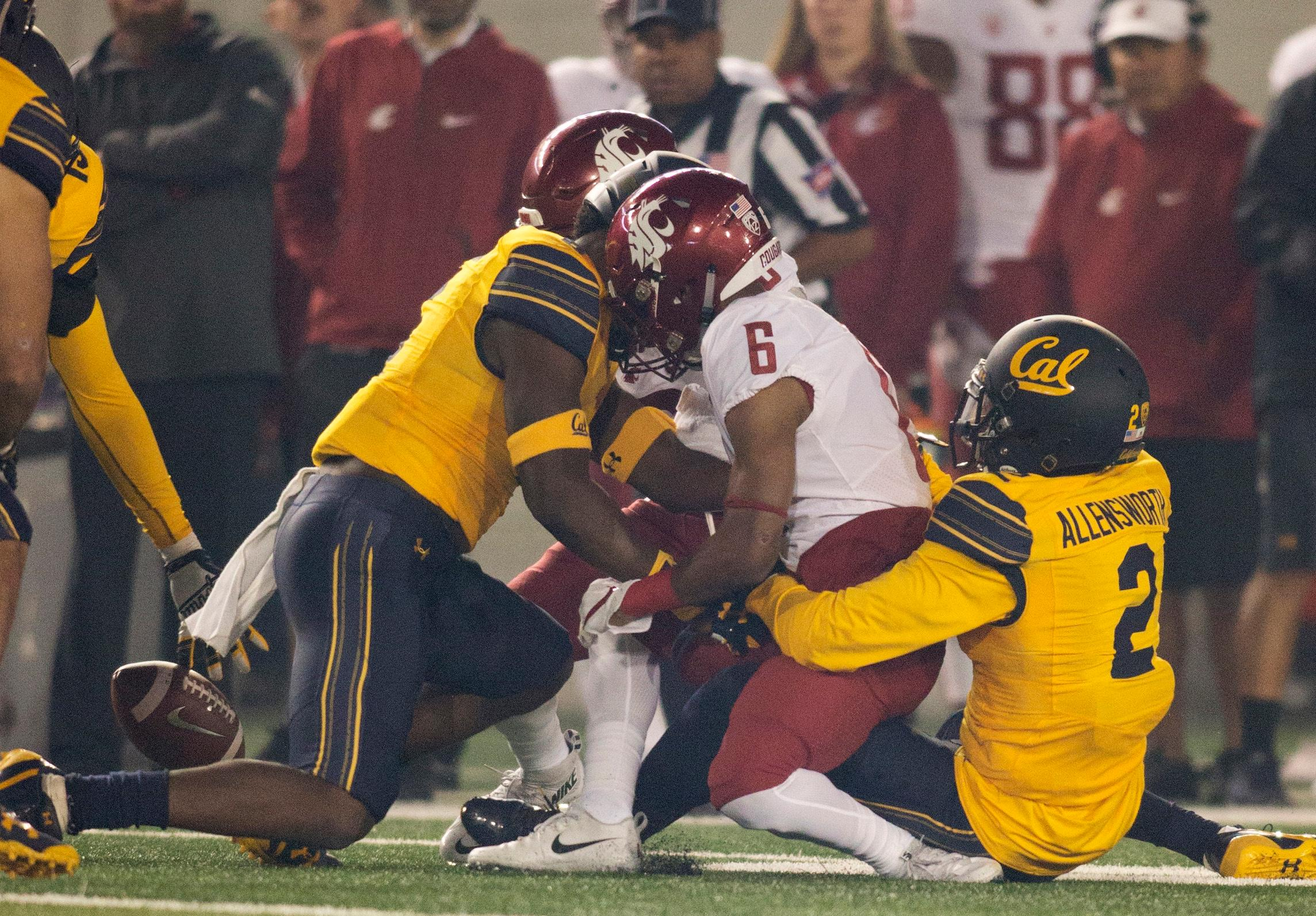 Washington State's Jamire Calvin (6) fumbles during the first quarter of an NCAA college football game against California, Friday, Oct. 13, 2017, in Berkeley, Calif. California recovered the ball. (AP Photo/D. Ross Cameron)