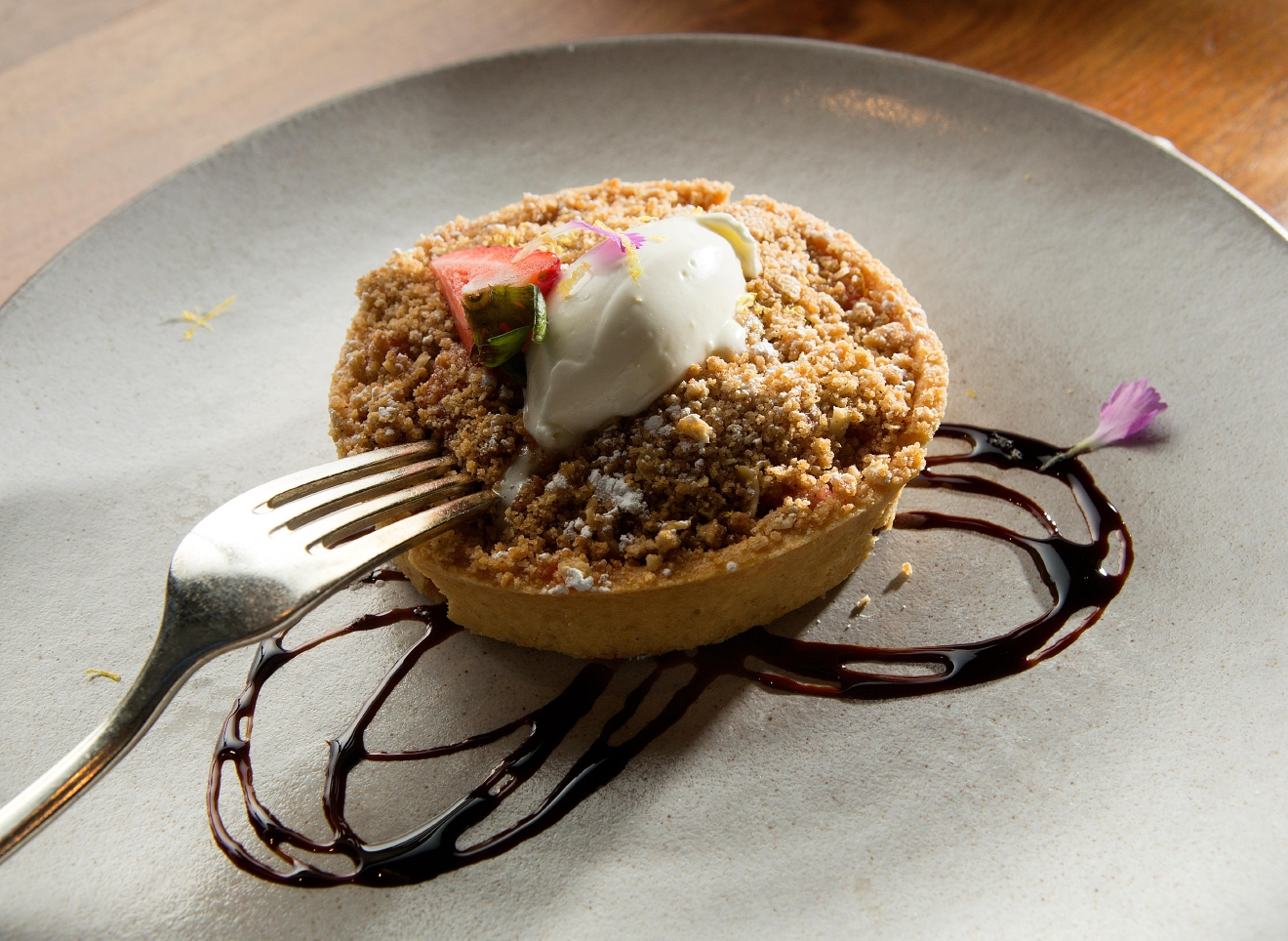 For dessert, Chef Joe Ritchie serves up a Strawberry Rhubarb Tart, with citrus creme fraiche, and balsamic sauce. (Sy Bean / Seattle Refined)
