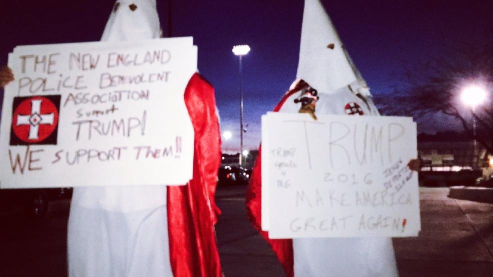Men dressed in KKK clothing stand in front of Cimarron High School caucus location | KSNV