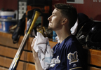 Milwaukee Brewers starting pitcher Zach Davies sits in the dugout after being removed during the sixth inning against the Cincinnati Reds, Tuesday, Sept. 5, 2017, in Cincinnati.