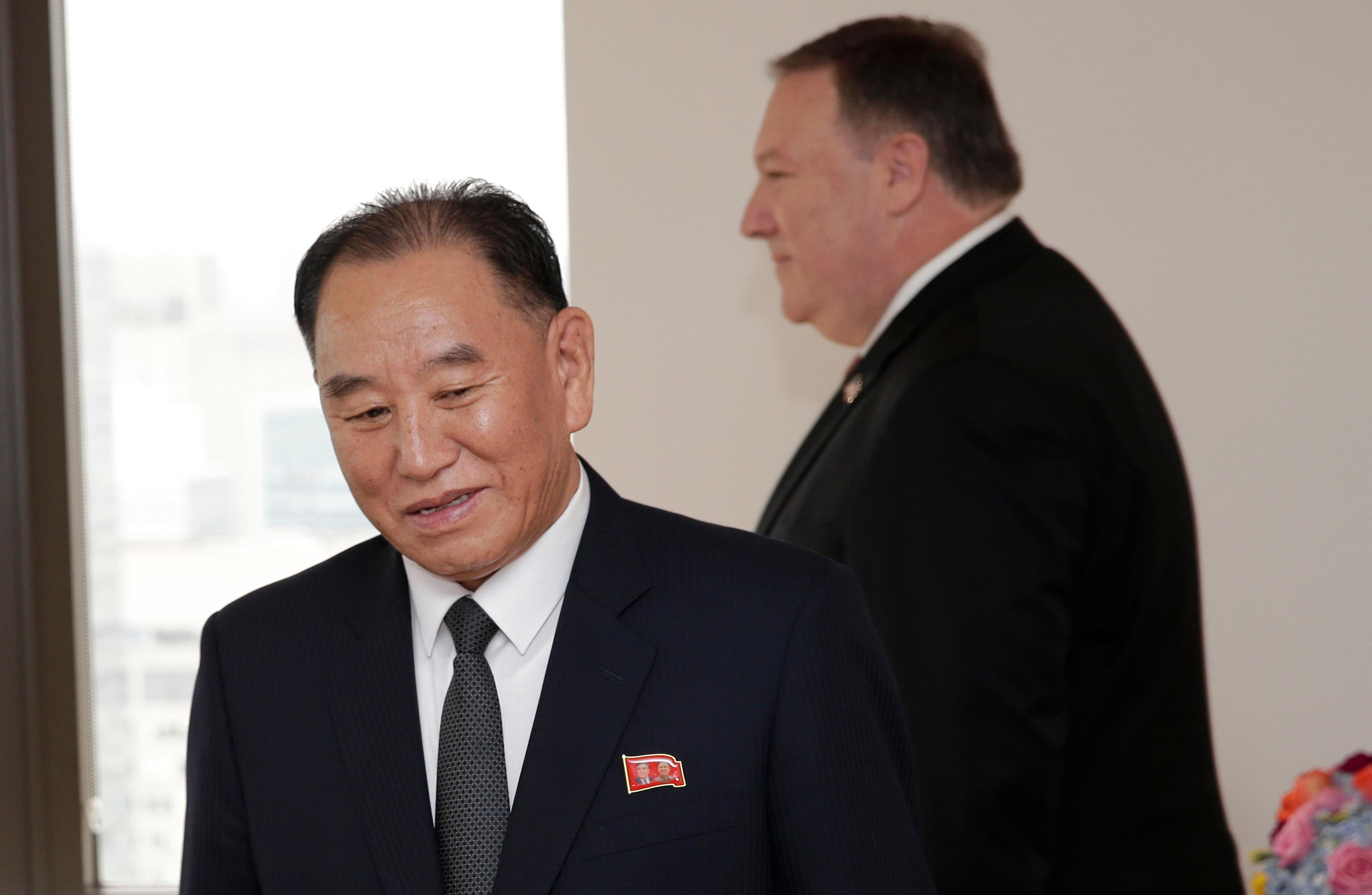 Kim Yong Chol, former North Korean military intelligence chief and one of Kim Jong Un's closest aides, left, and U.S. Secretary of State Mike Pompeo take their places at the table before a meeting, Thursday, May 31, 2018, in New York. (AP Photo/Seth Wenig)