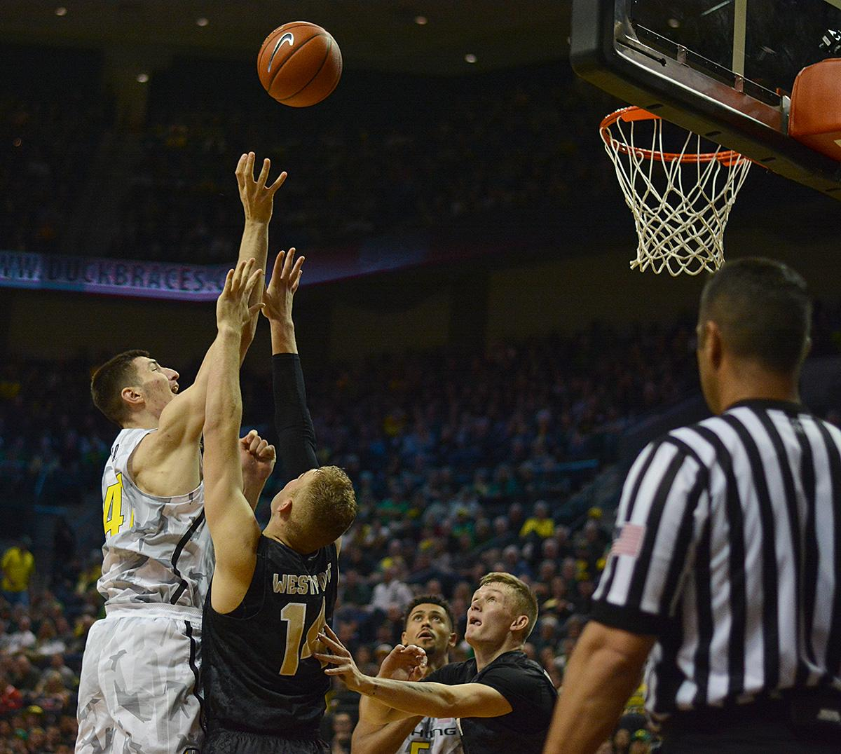 Ducks' Roman Sorkin (#41) jumps above Army's Matthew Wilson (#14) to get the shot off. In front of a sold out crowd, Oregon defeated Army 91-77 on opening night. Photo by Jacob Smith, Oregon News Lab