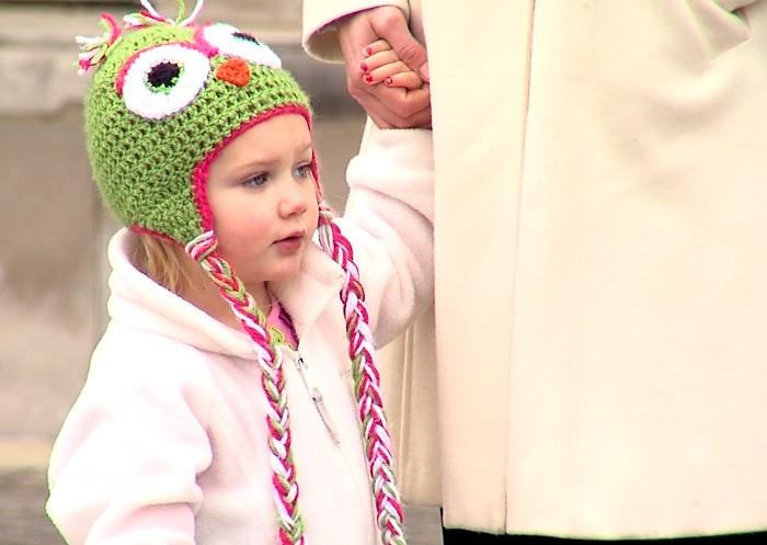 This young girl watched the circus roll into downtown Birmingham on Wednesday.