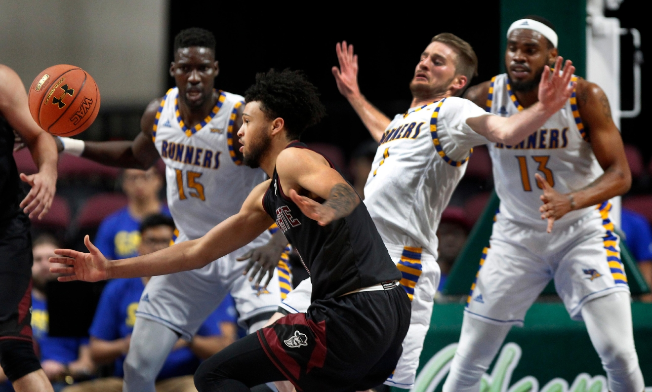New Mexico State guard Jermaine Haley (1) eyes a loose ball after colliding with Cal State Bakersfield guard Brent Wrapp (1) during the first half of an NCAA college basketball game in the final of the Western Athletic Conference tournament on Saturday, March 11, 2017, in Las Vegas. (AP Photo/L.E. Baskow)