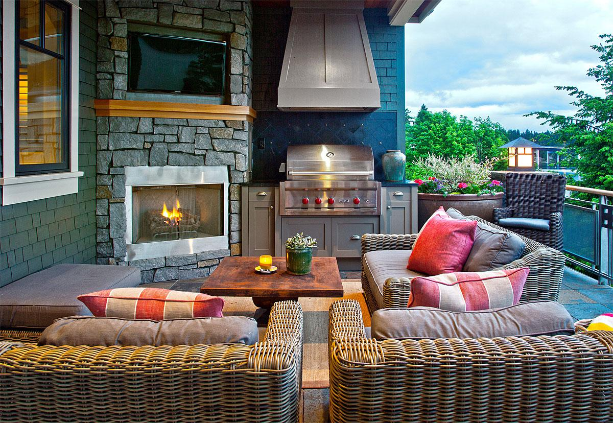 This Mercer Island Custom Estate was completely remodel after a fire destroyed the home in 2008. The outdoor living area has a television, fireplace and BBQ and was completed by Shulter Architecture.   (Image: Custom Estate / Porch.com)