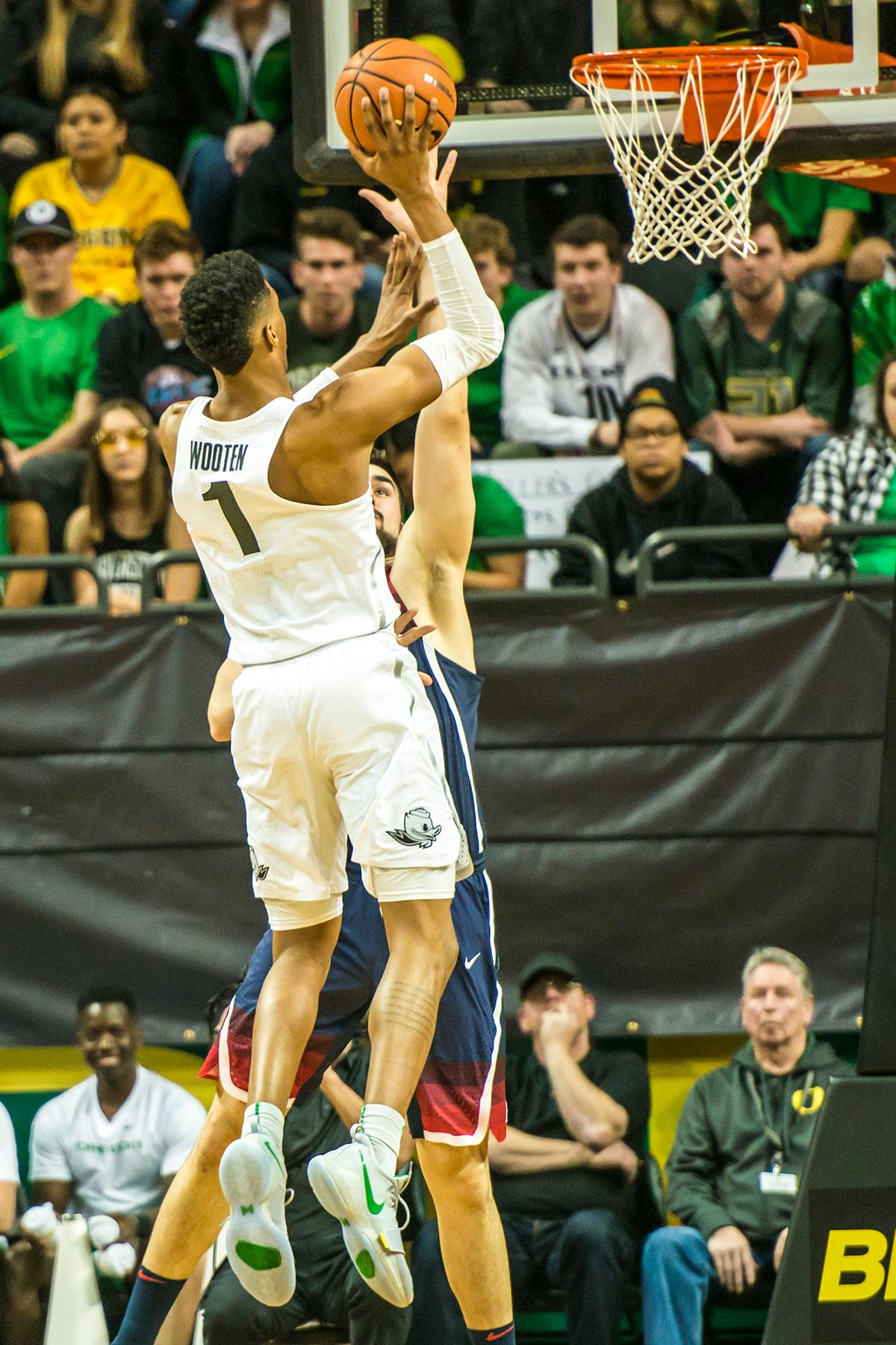 Oregon's Kenny Wooten (1) shoots over an Arizona defender in theor matchup at Matthew Knight Arena Saturday. The Ducks upset the fourteenth ranked Wildcats 98-93 in a stunning overtime win in front of a packed house of over 12,000 fans for their final home game to improve to a 19-10 (9-7 PAC-12) record on the season. Oregon will finish out regular season play on the road in Washington next week against Washington State on Thursday, then Washington on the following Saturday. (Photo by Colin Houck)