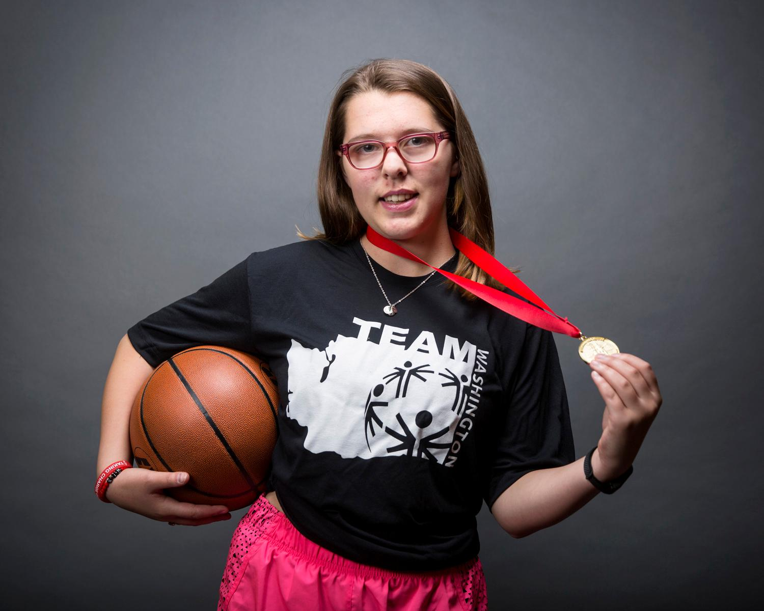 Introducing Kaylee Clark! Kaylee will be competing in Basketball. The Special Olympics USA will take place in Seattle from July 1-6, with a grand opening ceremony and Parade of Athletes and the lighting of the Special Olympics Flame of Hope. (Sy Bean / Seattle Refined)