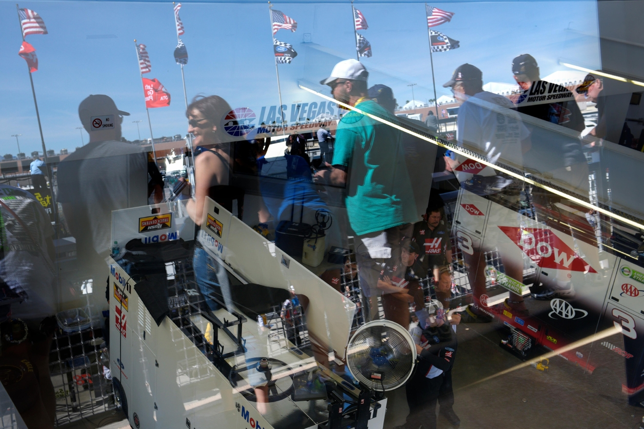 Fans are reflected in the glass of the Neon Garage during the NASCAR Xfinity Series Boyd Gaming 300 Saturday, March 11, 2017, at the Las Vegas Motor Speedway. (Sam Morris/Las Vegas News Bureau)