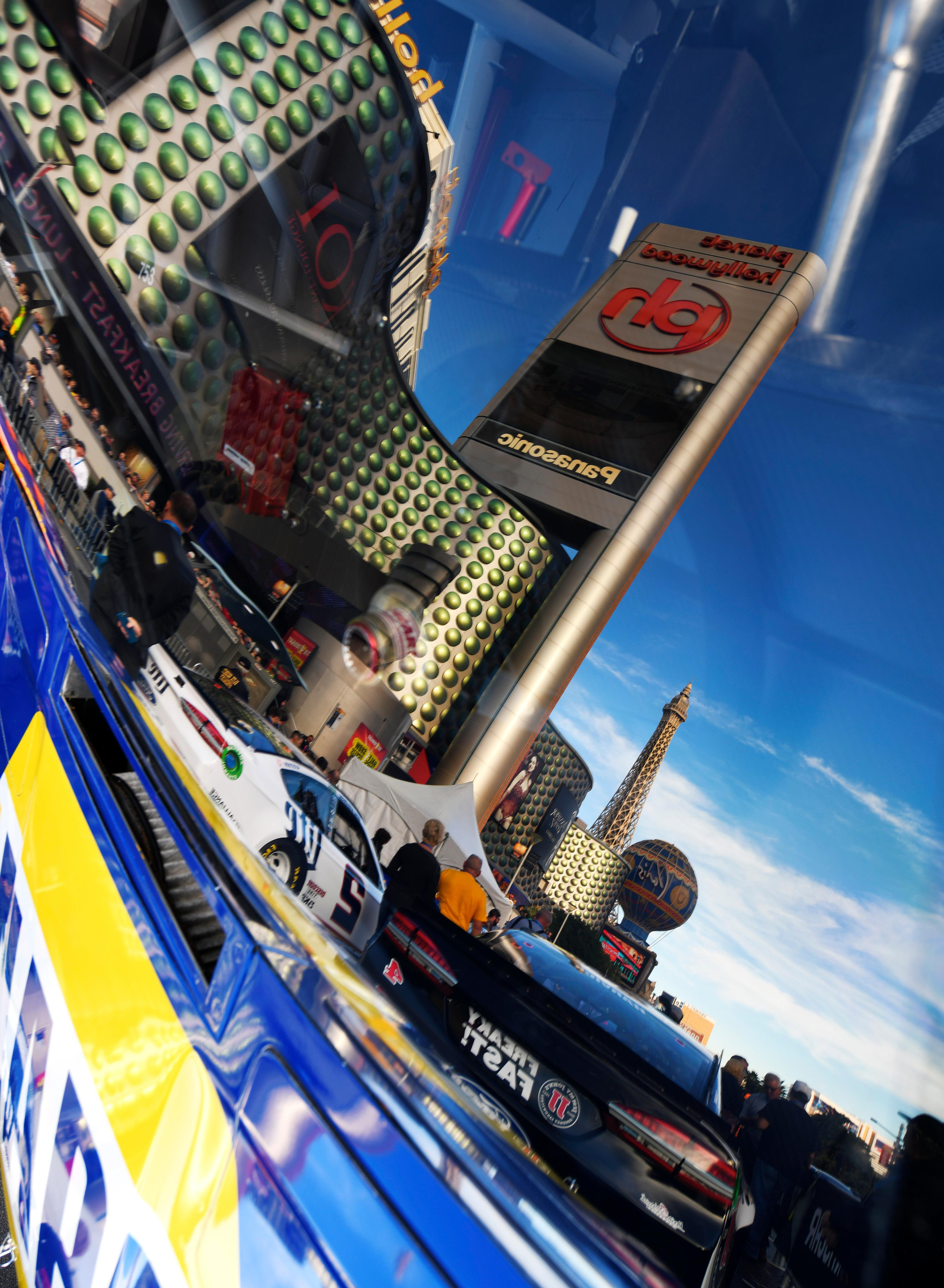 Marquees are reflected in the window of a stock car during the NASCAR Victory Lap on the Las Vegas Strip being held as part of Champions Week Wednesday, November 29, 2017. CREDIT: Sam Morris/Las Vegas News Bureau