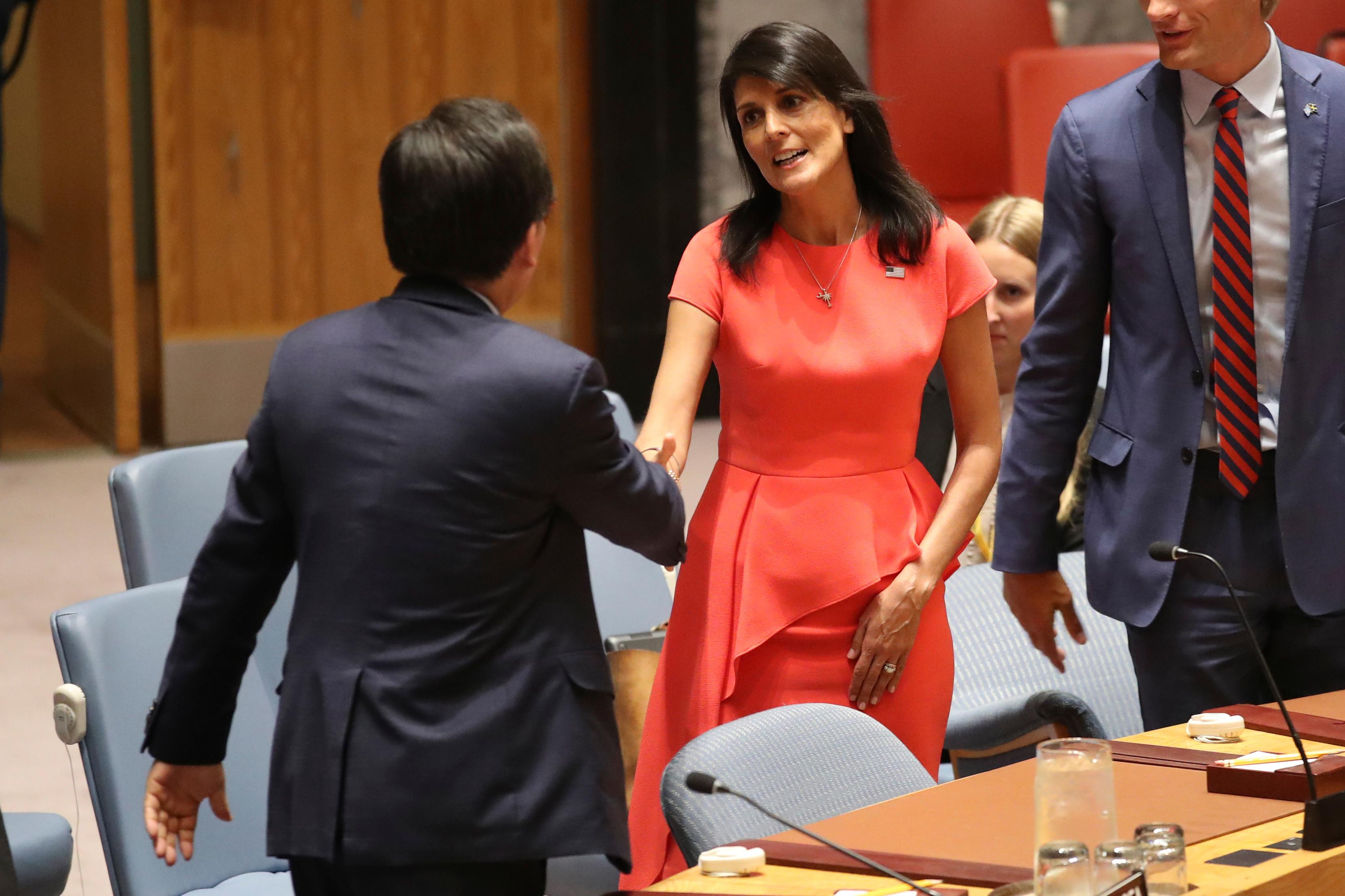 U.S. Ambassador to the United Nations Nikki Haley, right, speaks to South Korean Ambassador to the United Nations Cho Tae-yul before a Security Council vote on a new sanctions resolution that would increase economic pressure on North Korea to return to negotiations on its missile program, Saturday, Aug. 5, 2017 at U.N. headquarters. (AP Photo/Mary Altaffer)