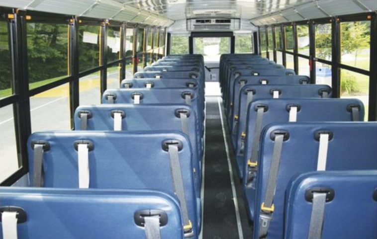 New seat belts are coming to several buses in Transylvania County Schools. These follow other far-reaching upgrades to ensure student safety, including extended stop arms, additional cameras all around yellow school buses, and new hand signals for all drivers on morning and afternoon routes where students cross the road. (Photo credit: Transylvania County Schools)