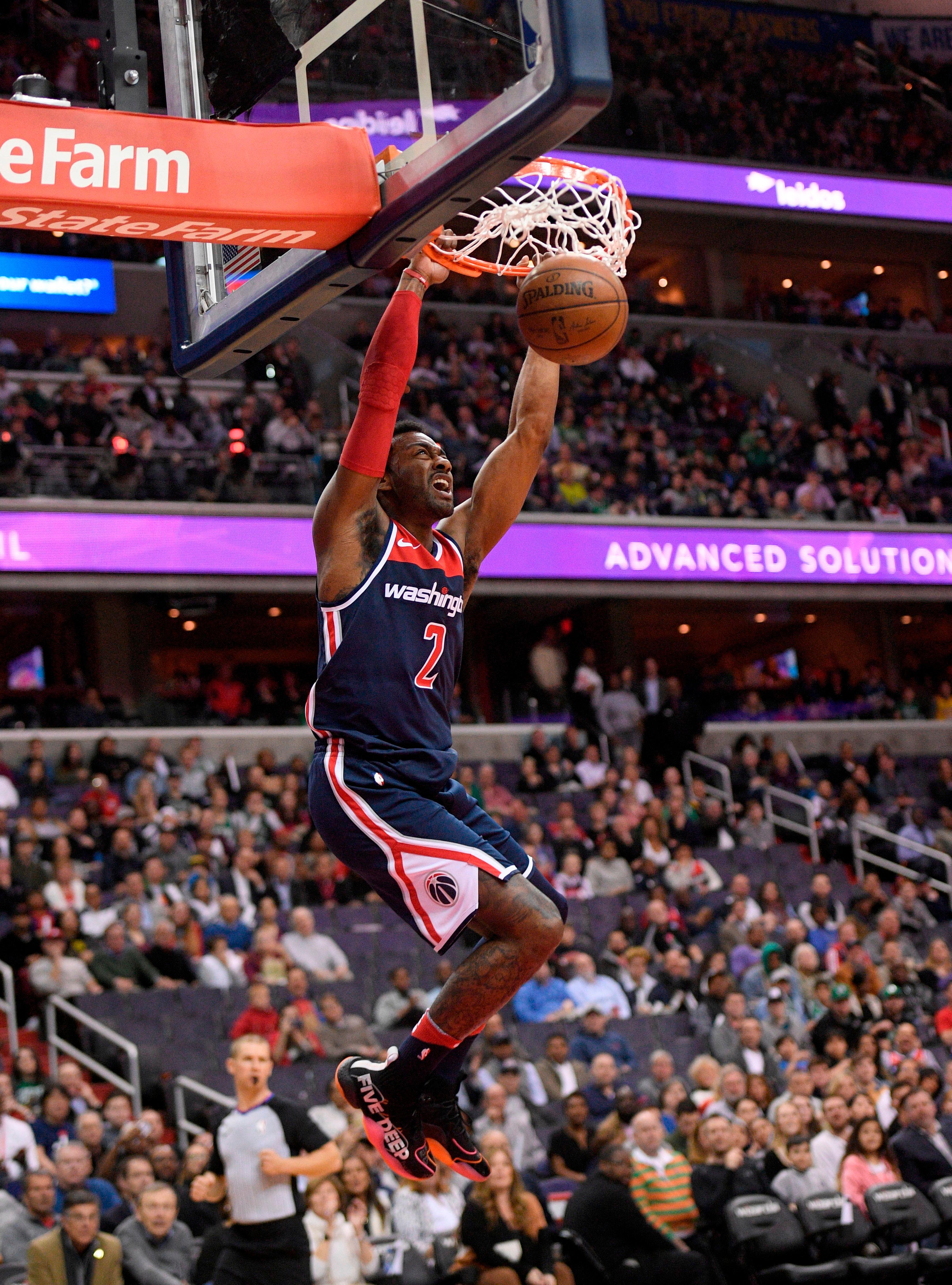 Washington Wizards Guard John Wall Dunks During The First Half Of Teams NBA Basketball Game
