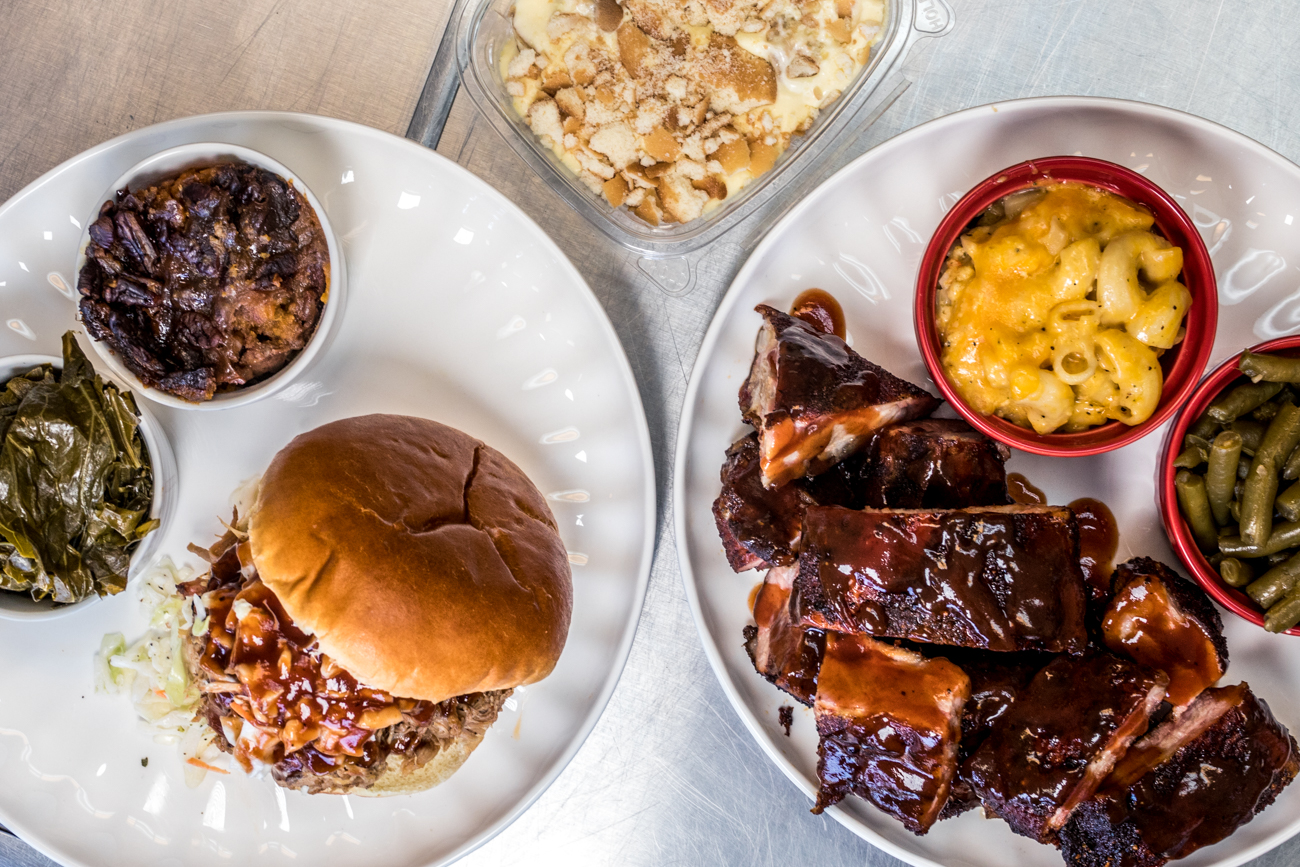 Pulled pork sandwich with collards and sweet potato casserole, rib tips with mac and cheese and green beans, and banana pudding from Sweets & Meats BBQ/ Image: Catherine Viox // Published: 8.28.20