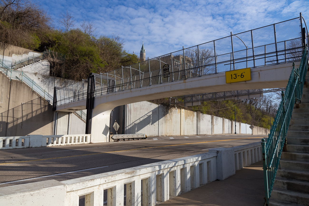 The pedestrian bridge also connects down to a walking path on Columbia Parkway. Following this path toward the city empties out onto 5th Street. / Image: Phil Armstrong, Cincinnati Refined // Published: 4.13.18