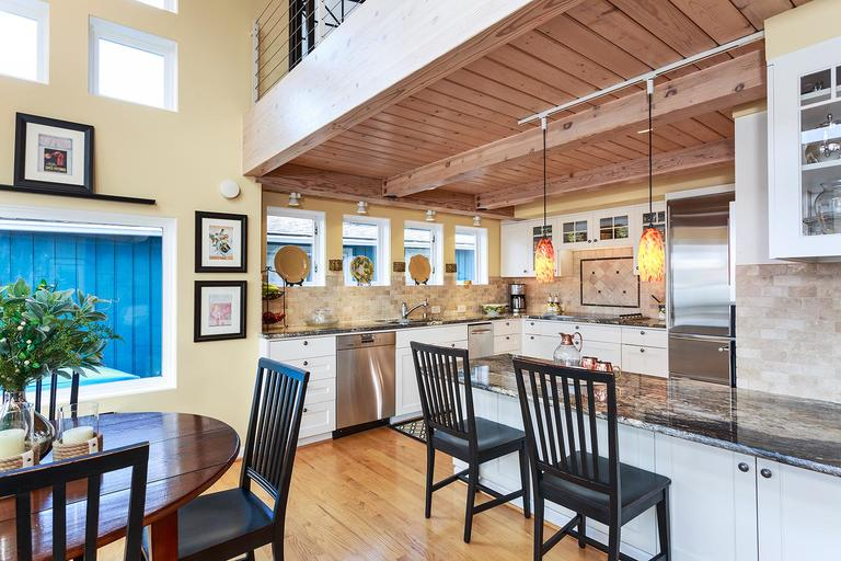 *UPDATE: This is back off the market! The seller decided they didn't want to sell after all...we don't blame them!This dreamy Lake Union houseboat will knock your Aqua Sox off! (Where did Aqua Sox even go? I miss those guys). Natural lights, two stories of windows, FOUR bedrooms - huge for a houseboat - and French doors because why the heck not. The master bedroom even has a fireplace, and the hot tub on deck is ideal for stargazing from the comfort of your own [floating] home. It's selling for $2,750,000 by Amy Dedoyard of Windermere. MLS 1196407 for more info. (Image: John McKinney Photographer)
