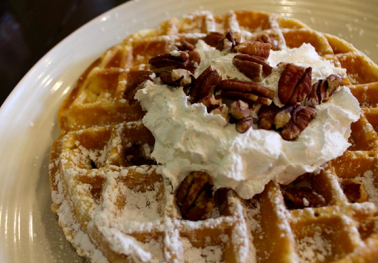 Belgian waffle with whipped cream, maple syrup, and pecans / Image: Rose Brewington // Published: 1.4.17