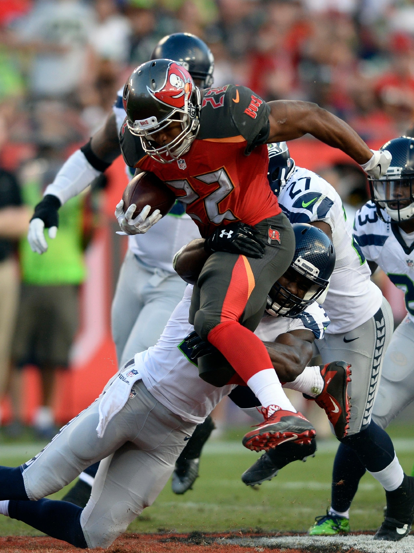 Tampa Bay Buccaneers running back Doug Martin (22) is lifted off the turf by Seattle Seahawks strong safety Kam Chancellor (31) during the second quarter of an NFL football game Sunday, Nov. 27, 2016, in Tampa, Fla. (AP Photo/Jason Behnken)