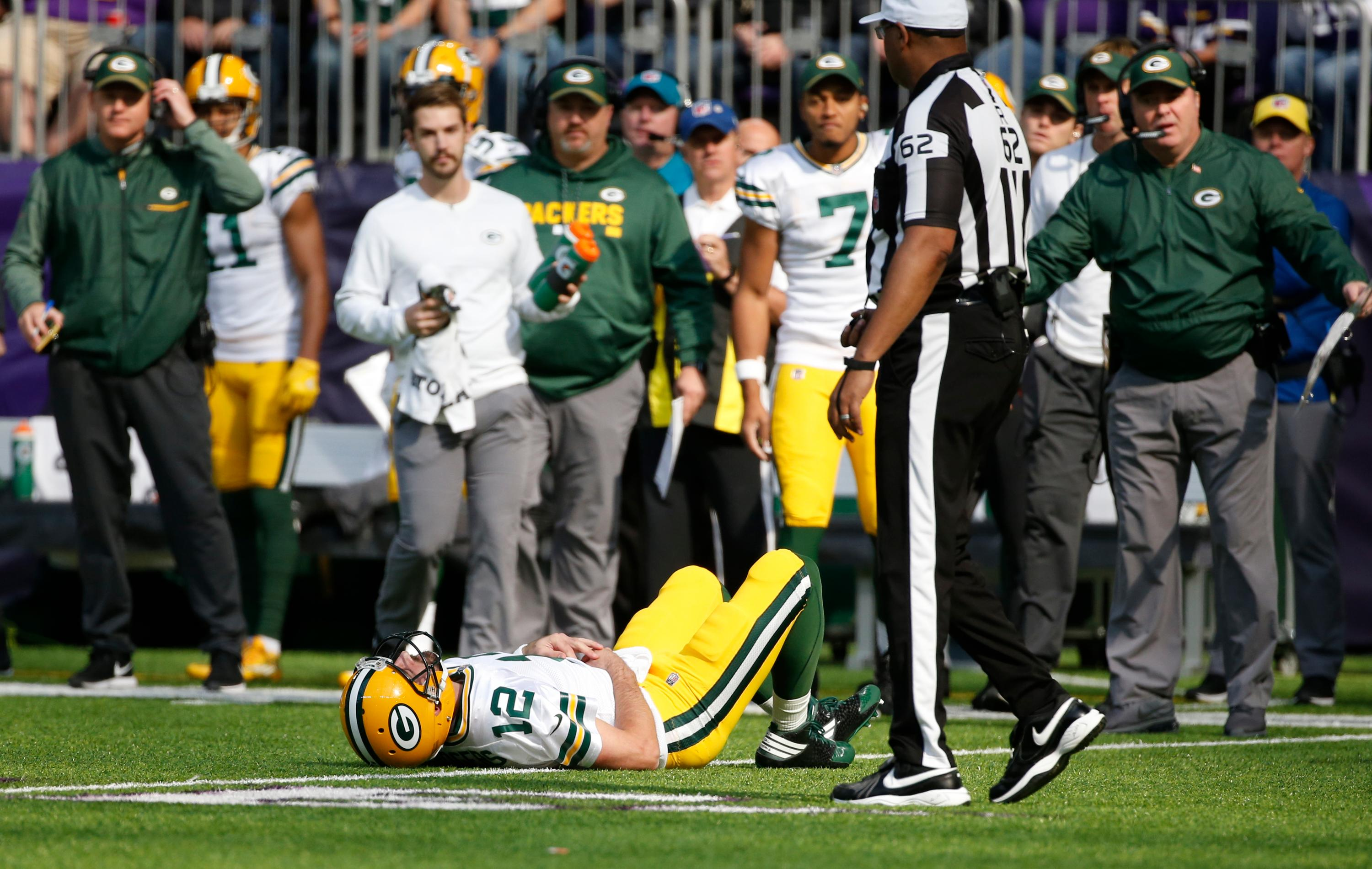 Green Bay Packers quarterback Aaron Rodgers (12) lies on the ground after being hit by Minnesota Vikings outside linebacker Anthony Barr (55) in the first half of a game in Minneapolis, Sunday, Oct. 15, 2017. (AP Photo/Bruce Kluckhohn)