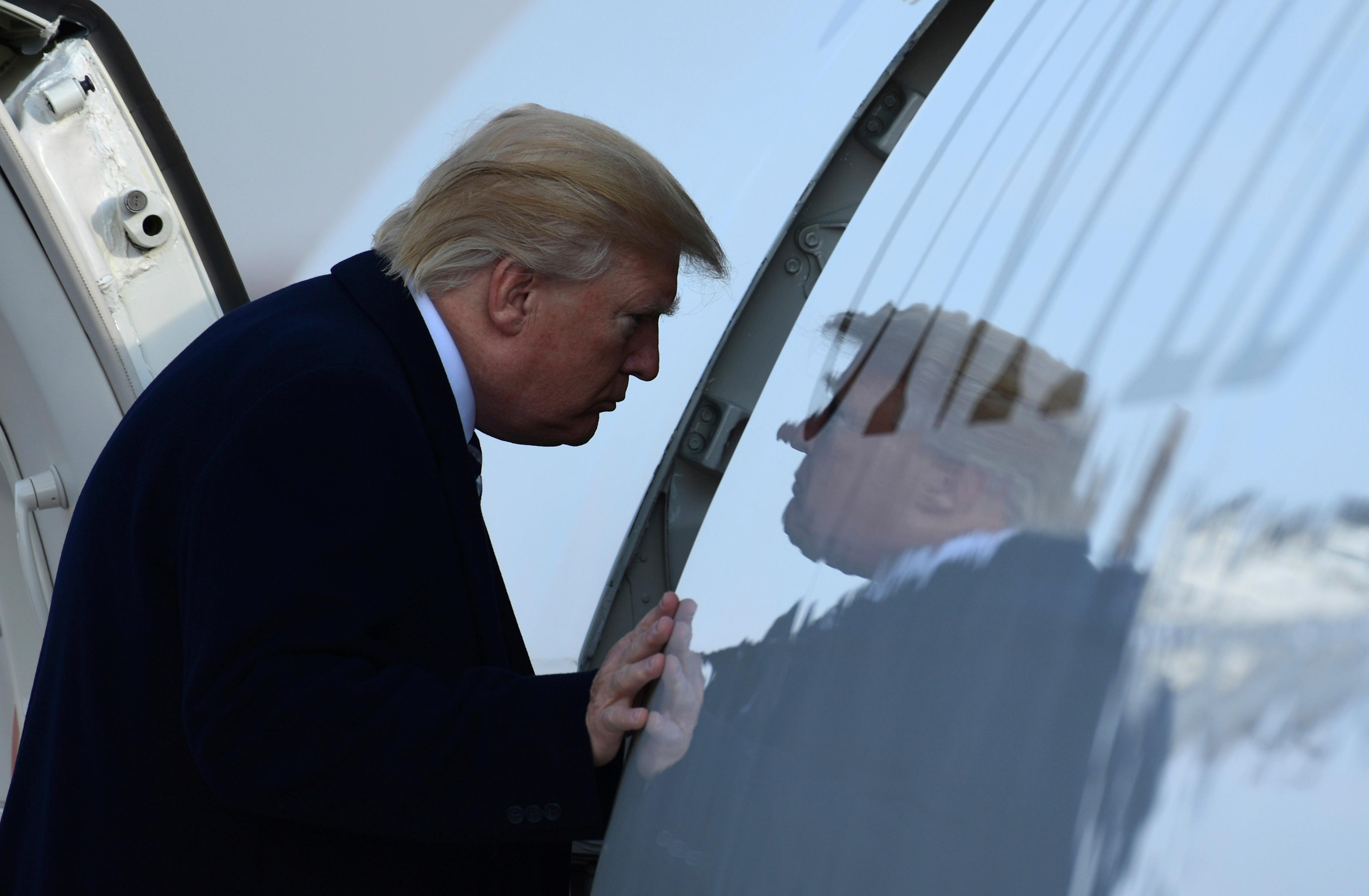 President Donald Trump walks up the steps of Air Force One at Andrews Air Force Base in Md., Saturday, Dec. 2, 2017. Trump is heading to New York to attend Republican fundraisers. (AP Photo/Susan Walsh)