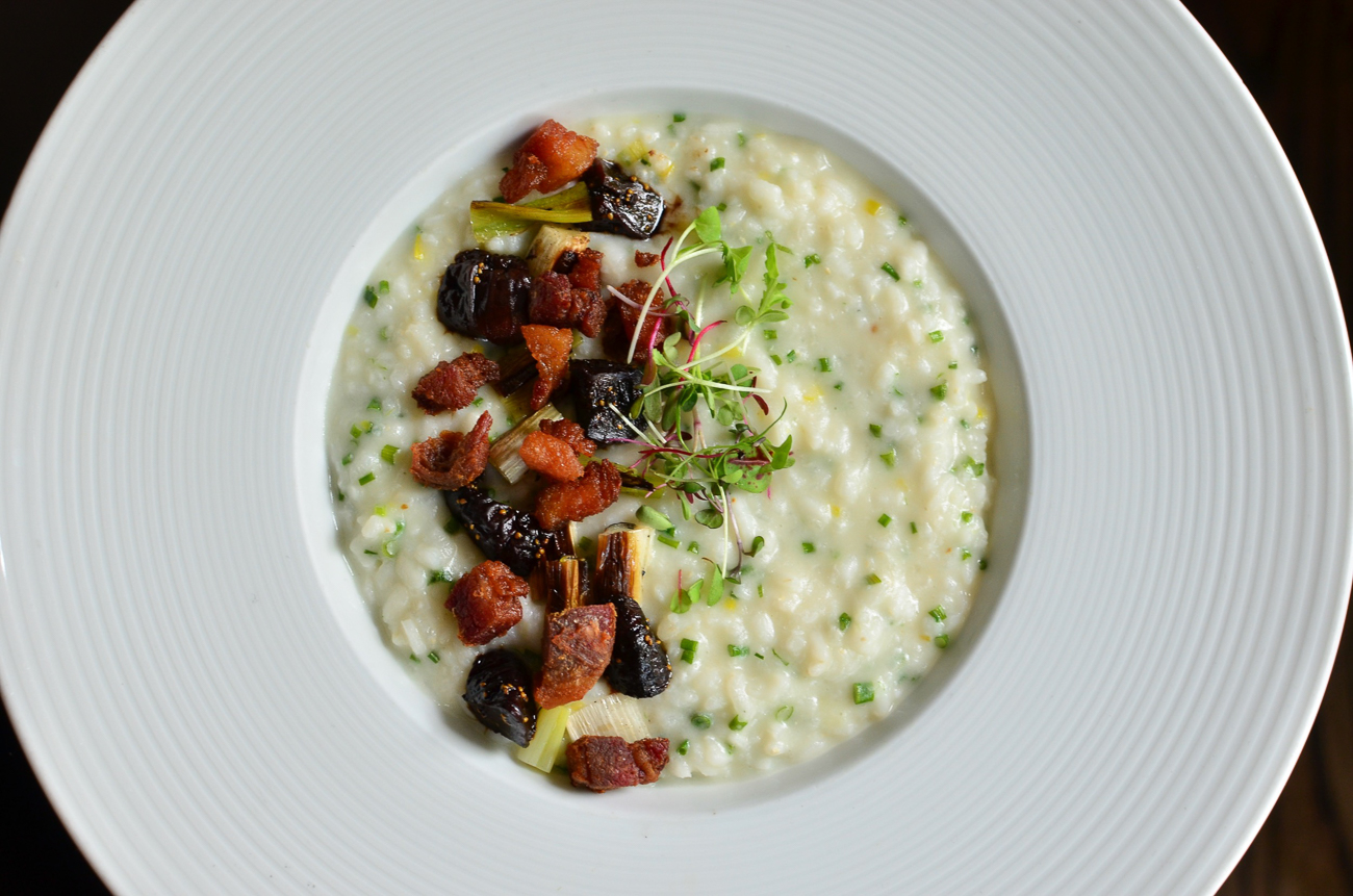 Risotto with pork belly, scallions, plums, and truffle mascarpone / Image courtesy of The Mercer OTR // Published: 5.14.20