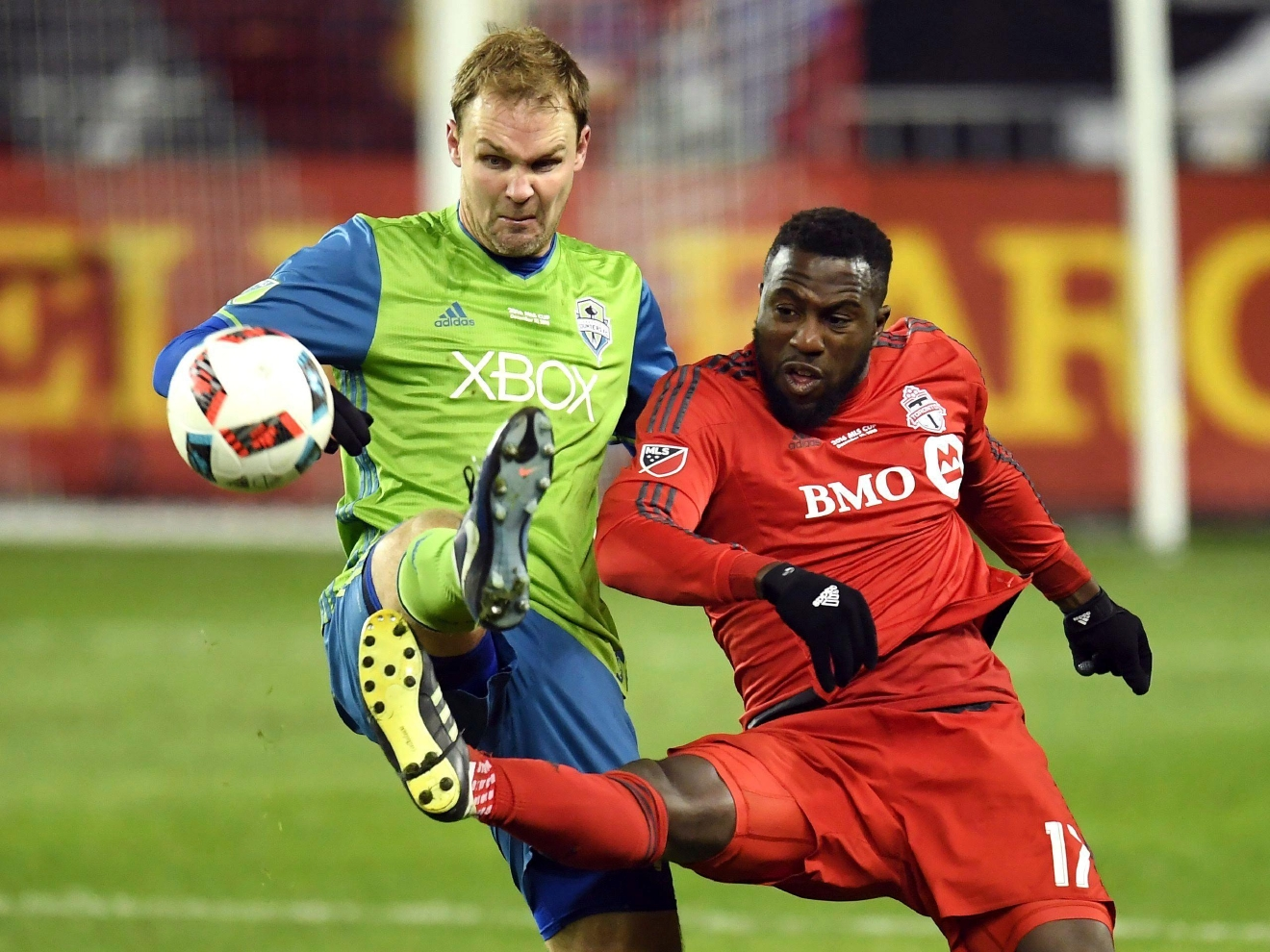 Seattle Sounders defender Chad Marshall, left, and Toronto FC forward Jozy Altidore (17) battle for the ball during second-half MLS Cup final soccer action in Toronto, Saturday, Dec. 10, 2016. (Franks GunnThe Canadian Press via AP)