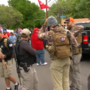 Hundreds of armed people line the streets to protest mistreatment of gun owners