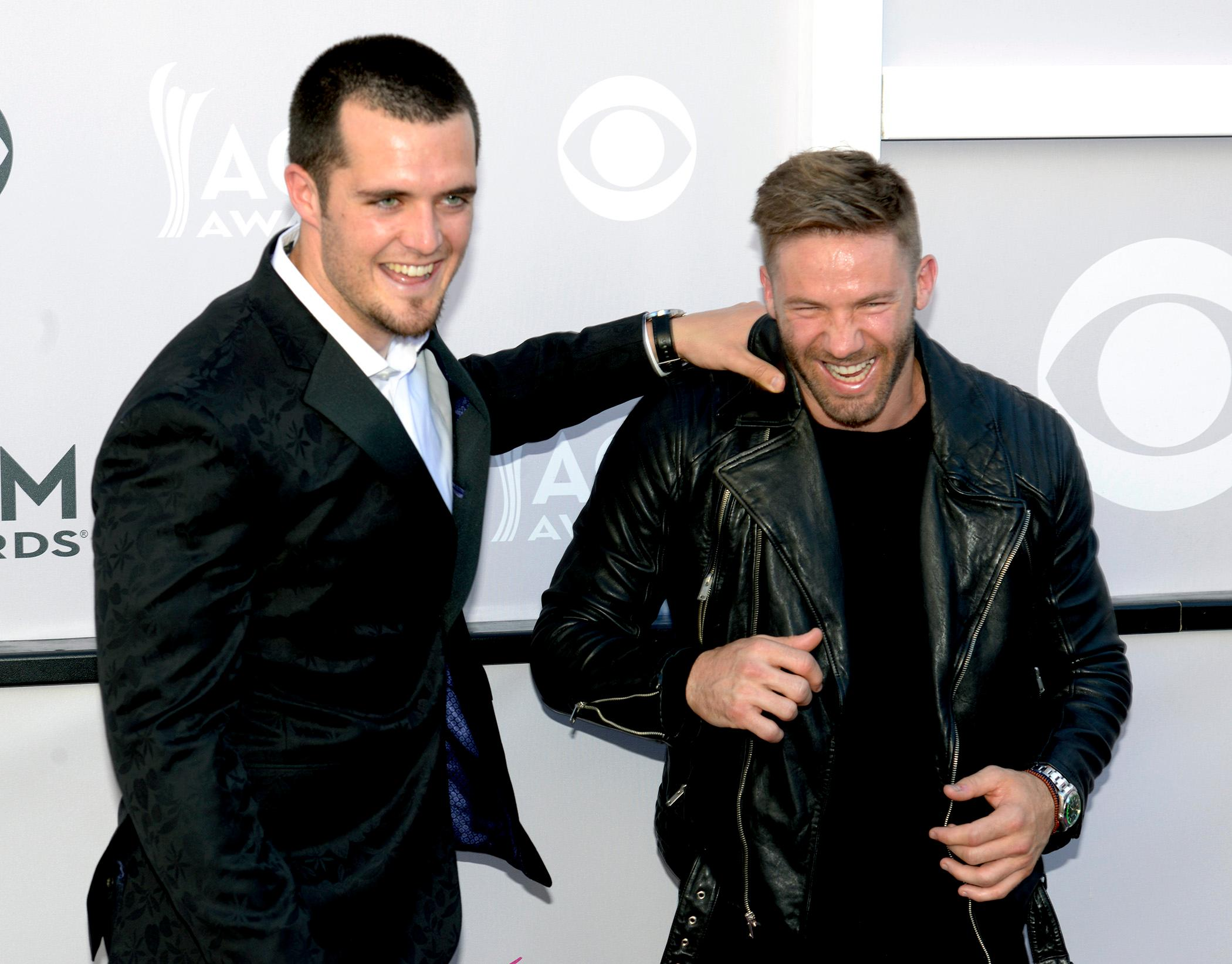 Derek Car, quarterback for the Oakland Raiders and Julian Edelman, wide receiver for the New England Patriots clown-around on the Academy of Country Music Awards red carpet at T-Mobile Arena. Sunday, April 2, 2017. (Glenn Pinkerton/ Las Vegas News Bureau)