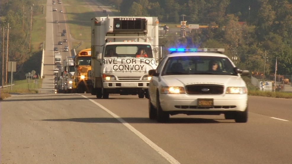 Convoy of cars and trucks drive through Tri-Cities to raise hunger