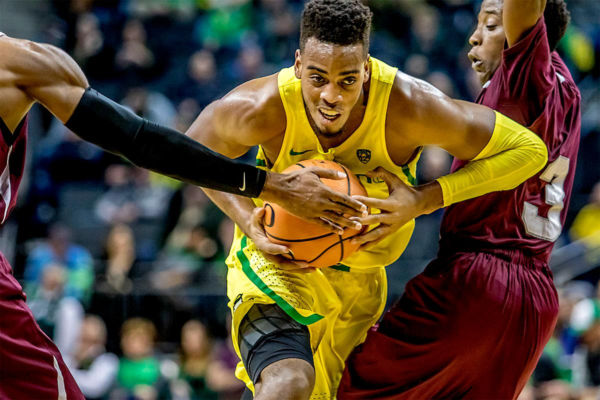 The Duck's Troy Brown (#0) pushes his way past the Tigers as he runs for the basket. The Oregon Ducks defeated Texas Southern Tigers 74-68. The Ducks are now 7-3 overall in the Pac-12. Photo by August Frank. Oregon News Lab