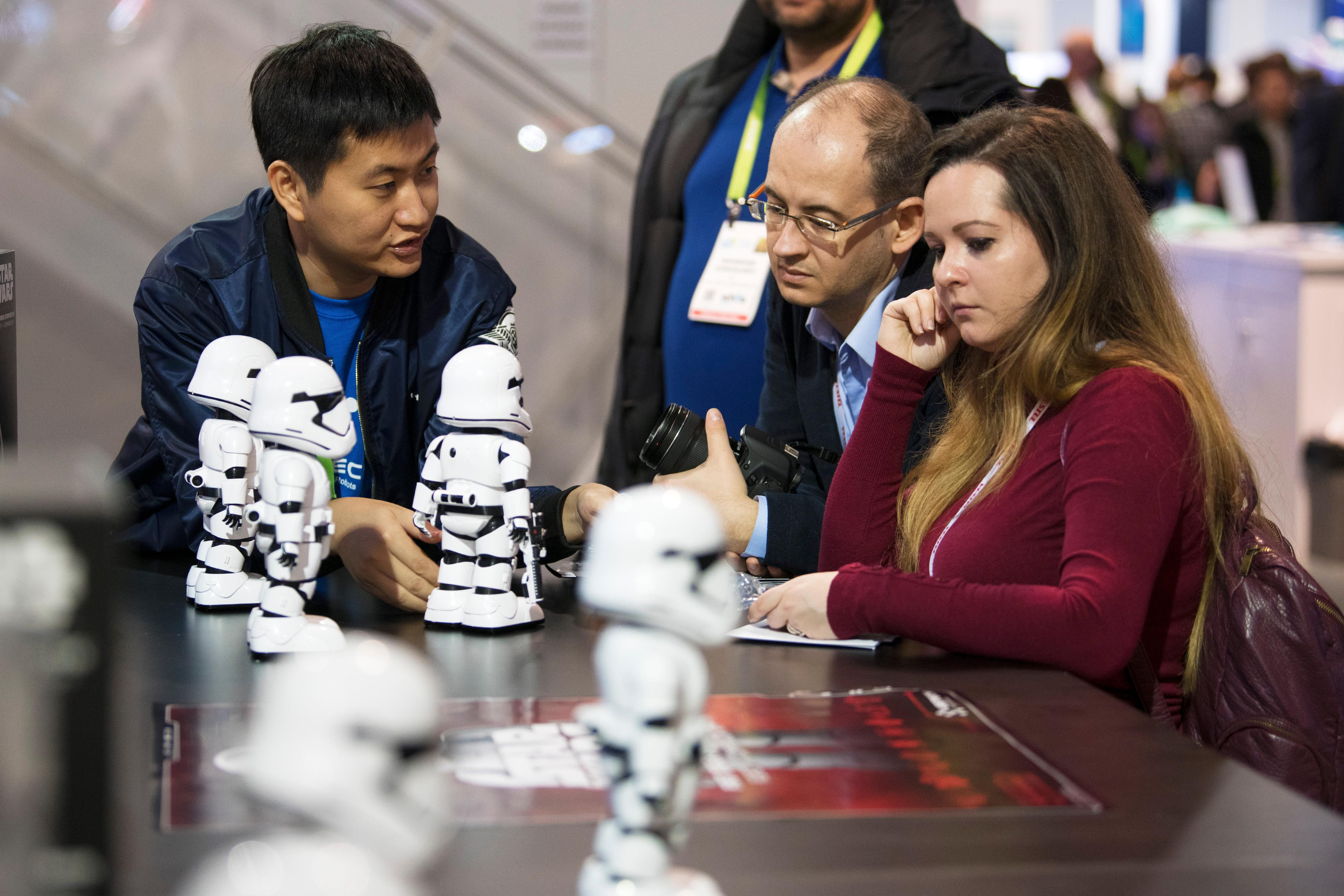 Wilson Chen from Ubtech demonstrates robotic New Order Stormtroopers from the most recent Star Wars film during the second day of CES Wednesday, January 10, 2018, at the Las Vegas Convention Center. CREDIT: Sam Morris/Las Vegas News Bureau