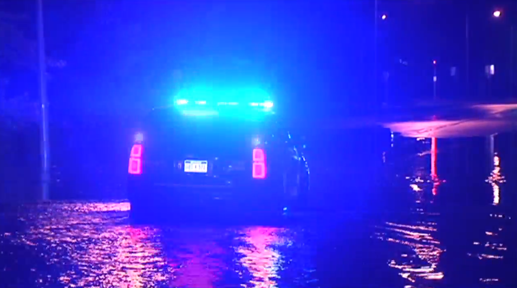 Police blocked roads on Tuesday morning to warn drivers of the flooding.