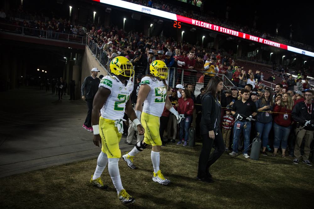 Oregon Ducks captains Royce Freeman (#21) and Henry Mondeaux (#92) walk onto the field for the coin toss. The Oregon Ducks are trailing the Stanford Cardinal 28-7 at halftime at Stanford Stadium in California.  Photo by Austin Hicks, Oregon News Lab
