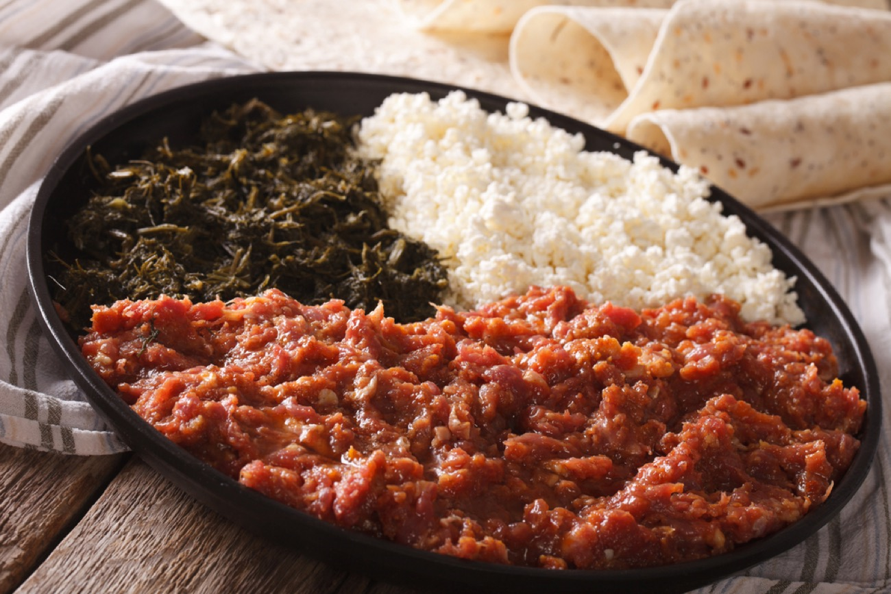 Special Kitfo: Minced meat seasoned with herbed butter and hot red pepper and served with Ayeb Begomen, or cheese and spinach  / Image courtesy of Habesha Restaurant and Cafe // Published: 7.17.18