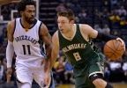 Milwaukee Bucks guard Matthew Dellavedova (8) drives against Memphis Grizzlies guard Mike Conley (11) in the first half of a game Monday, March 13, 2017, in Memphis, Tenn.