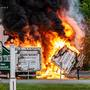 State Police: Man arrested after crashing car into box trucks, causing fire.