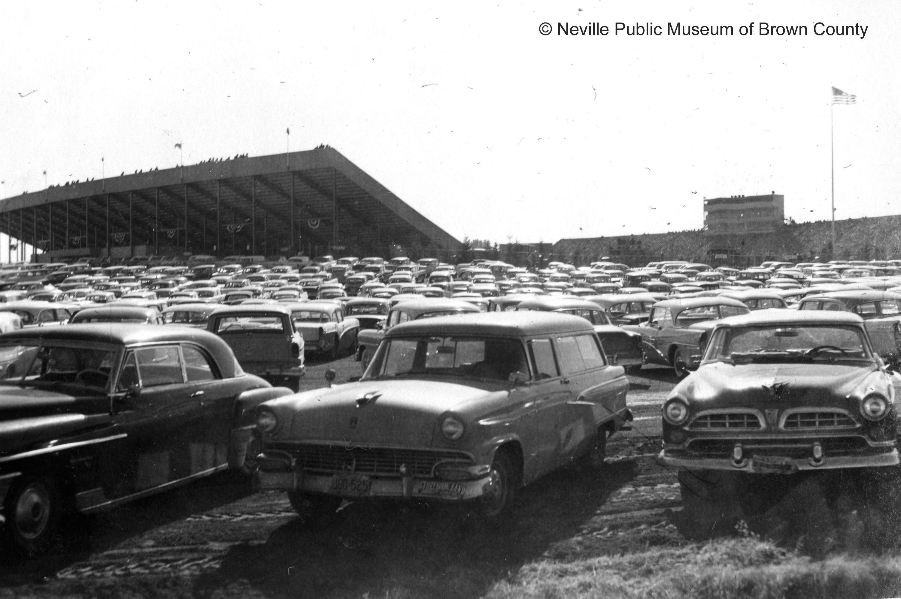 Green Bay Packers game fills grounds around New City Stadium with cars. It was built originally to seat 32,500.  In 1965, the stadium was renamed Lambeau Field after franchise founder Curly Lambeau. (Courtesy: Neville Public Museum of Brown County)