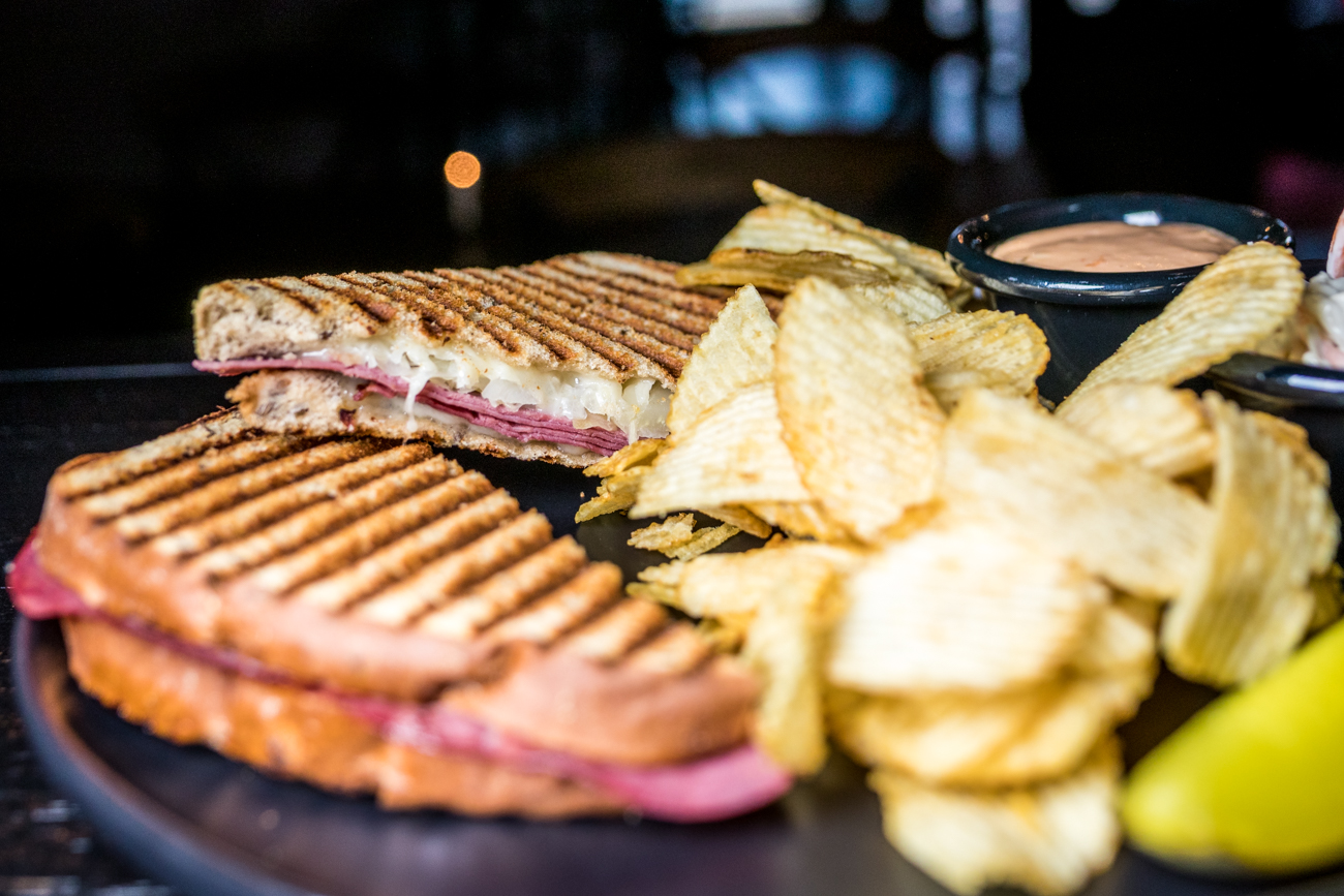 Reuben Melt: lean corn beef, Wisconsin swiss, sauerkraut, thousand island dressing, rye bread served with chips, slaw, and a pickle / Image: Catherine Viox{ }// Published: 2.25.21