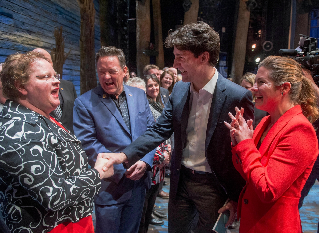 "Canadian Prime Minister Justin Trudeau, center, and his wife Sophie Gregoire chat with some of the citizens from Gander, Newfoundland, after the Broadway musical ""Come From Away"" in New York on Wednesday, March 15, 2017. Trudeau, along with first daughter Ivanka Trump, have welcomed the new musical that celebrates Canadian compassion following 9/11. The musical is set in the small Newfoundland town of Gander, which opened its arms and homes to some 7,000 airline passengers diverted there when the U.S. government shut down its airspace. (Ryan Remiorz/The Canadian Press via AP)"