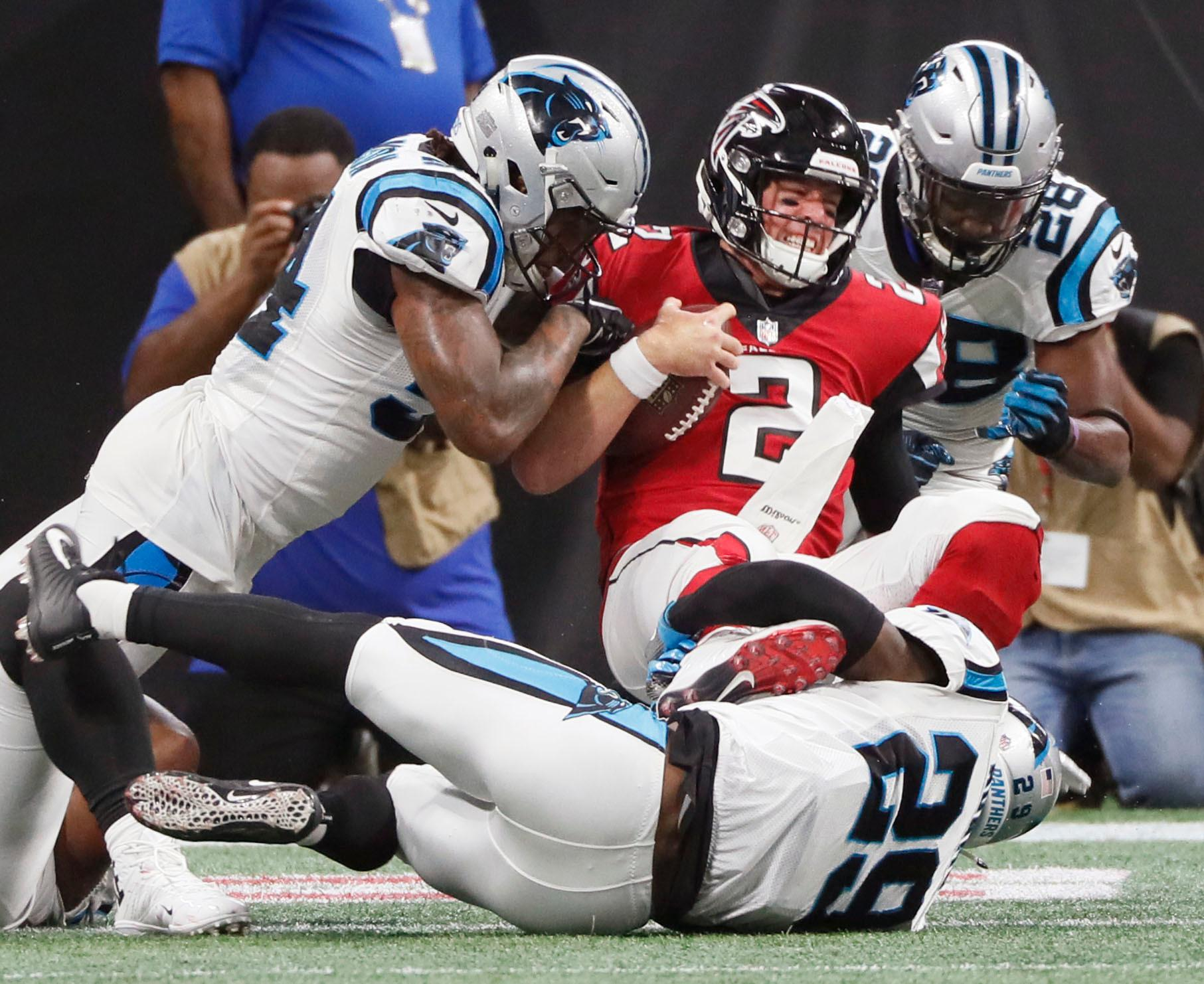 Atlanta Falcons quarterback Matt Ryan (2) muscles across the goal line through Carolina Panthers defenders on a keeper to score during the second half of an NFL football game, Sunday, Sept 16, 2018, in Atlanta. (Bob Andres/Atlanta Journal-Constitution via AP)