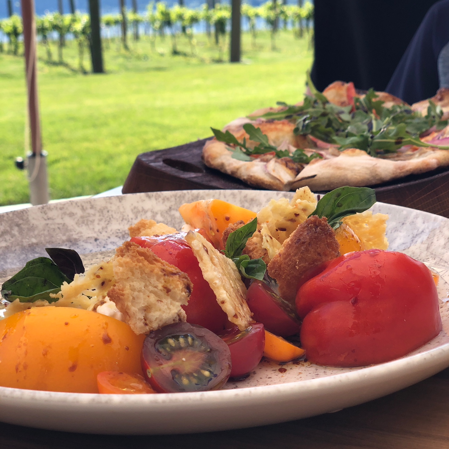 Salad and flatbread from Block One Restaurant at 50th Parallel Estate Winery. (Image: Terumi Pong / Seattle Refined)