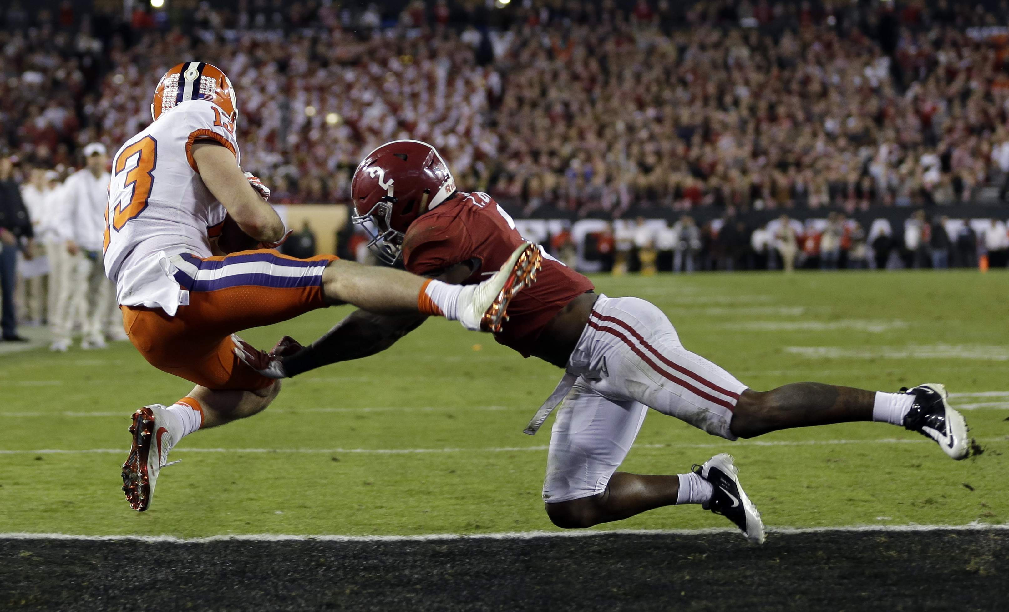 Clemson's Hunter Renfrow catches a touchdown pass in front of Alabama's Tony Brown during the second half of the NCAA college football playoff championship game early Tuesday, Jan. 10, 2017, in Tampa, Fla. THE ASSOCIATED PRESS