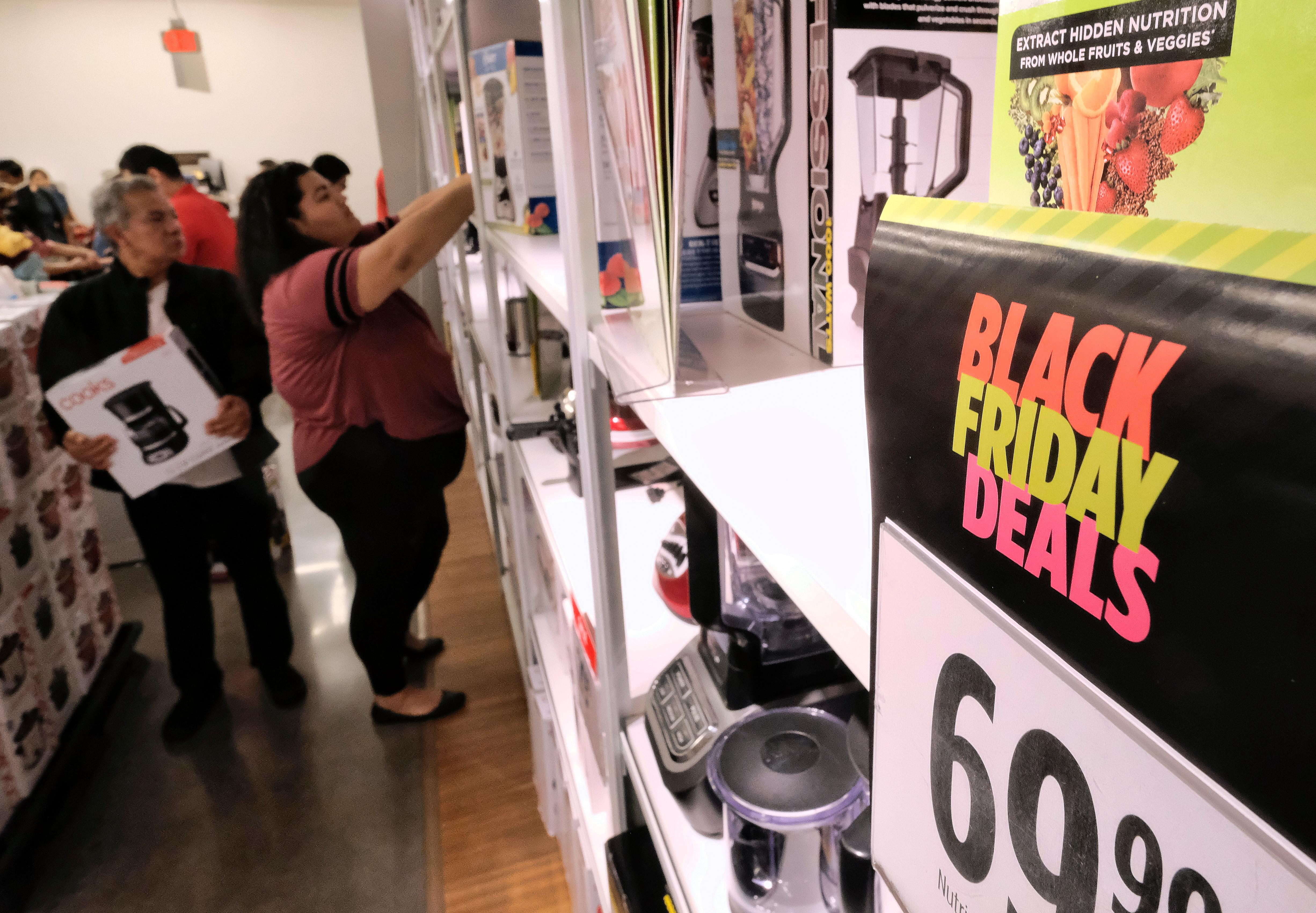 Thanksgiving holiday shoppers check out the bargains at the JCPenny store in Glendale, Calif., Thursday, Nov. 23, 2017. Shoppers are hitting the stores on Thanksgiving as retailers under pressure look for ways to poach shoppers from their rivals. As the holiday shopping season officially kicked off, retailers are counting on a lift from a better economy. (AP Photo/Richard Vogel)